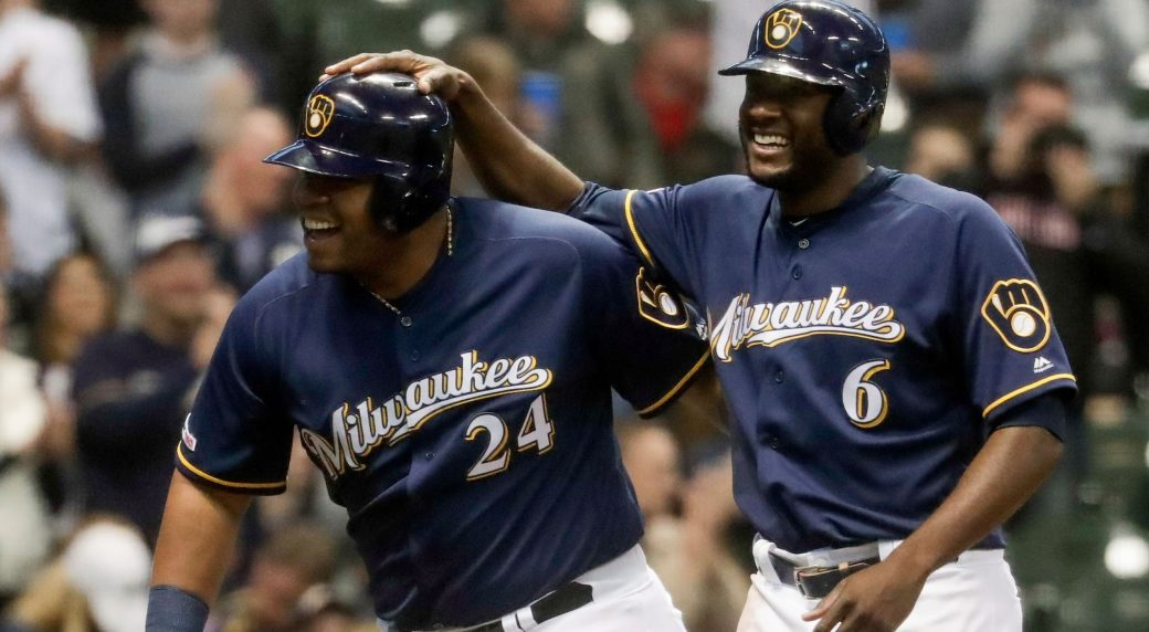 9ccc3c7b8 Milwaukee Brewers  Jesus Aguilar celebrates his three-run home run with  Lorenzo Cain (6) during the first inning of a baseball game against the  Colorado ...