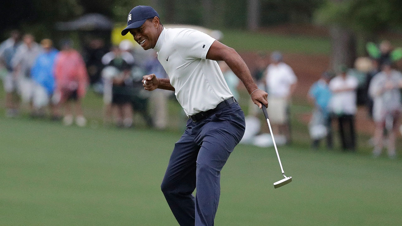Golf-PGA-Woods-celebrates-putt-at-Masters