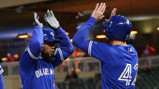 MLB-Blue-Jays-Hernandez-celebrates-home-run-versus-Twins
