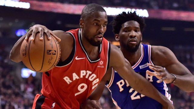 NBA-Raptors-Ibaka-drives-against-Sixers-Embiid