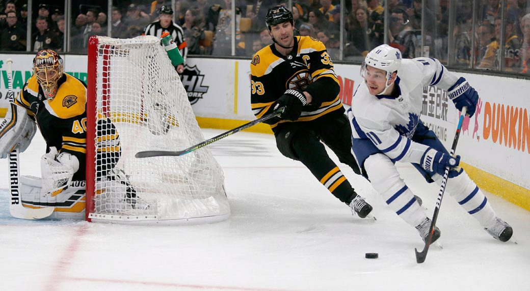 NHL-Maple-Leafs-Hyman-skates-behind-Bruins-net