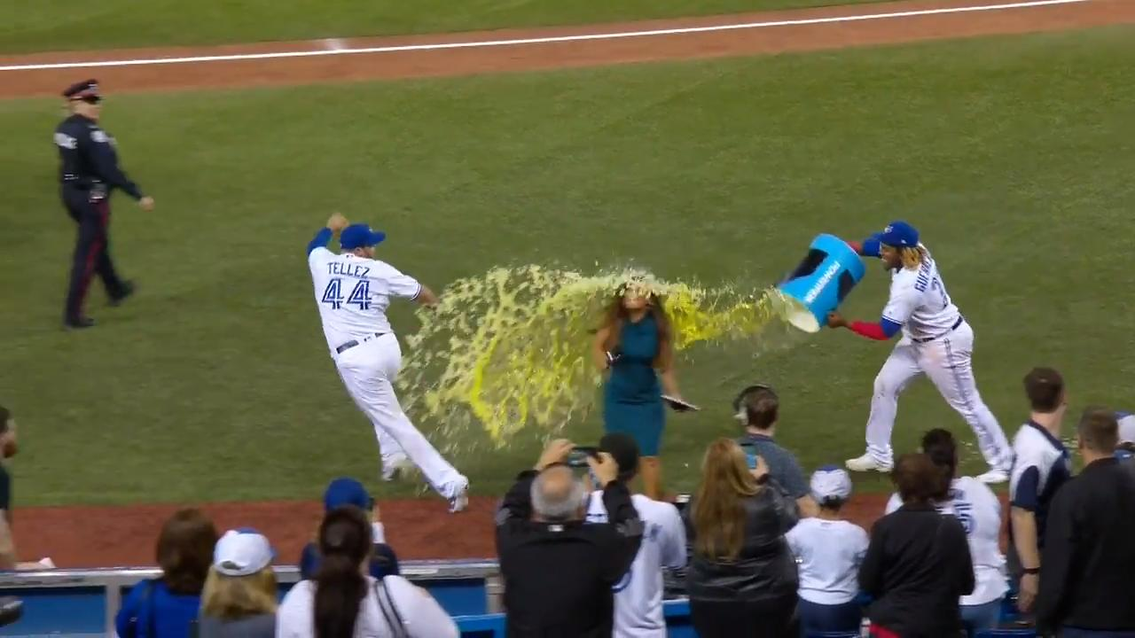 Vlad Jr. catches Rowdy Tellez and Hazel Mae with gatorade shower