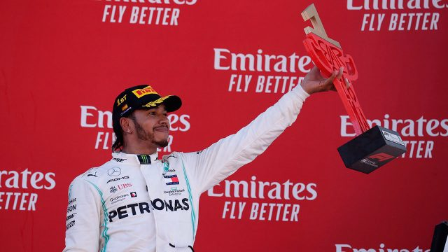 Auto-racing-F1-Hamilton-celebrates-after-winning-race