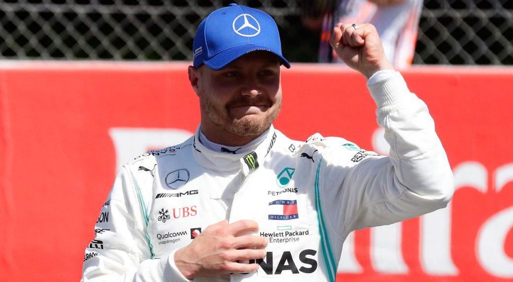 Auto-racing-Valtteri-celebrates-after-setting-pole-position