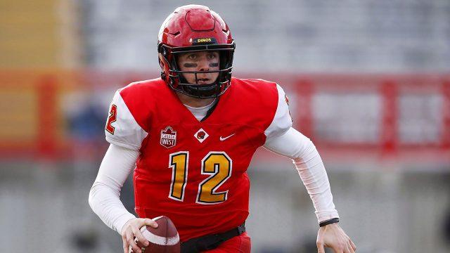 Football-Dinos-quarterback-Adam-Sinagra-moves-in-pocket