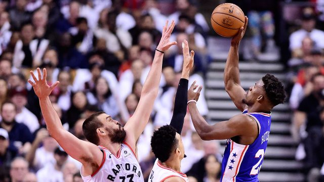 NBA-76ers-Butler-shoots-over-Raptors-Gasol-and-Green