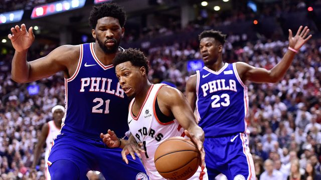 NBA-Raptors-Lowry-drives-against-76ers