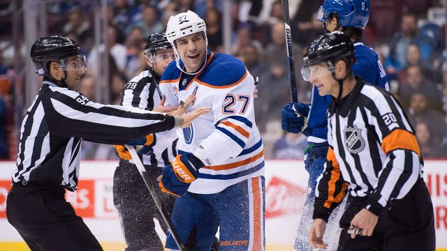 milan-lucic-laughs-with-referees-nearby